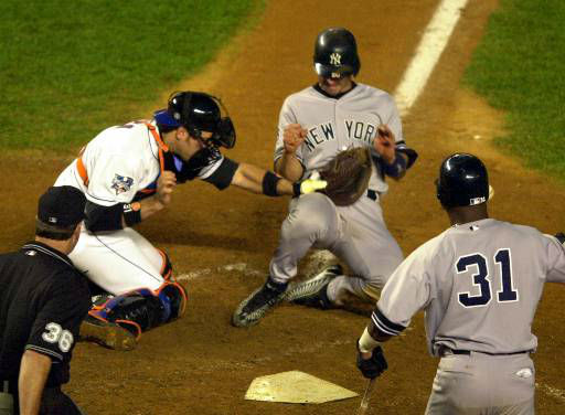 """<div class=""""meta image-caption""""><div class=""""origin-logo origin-image none""""><span>none</span></div><span class=""""caption-text"""">New York Yankees' Jorge Posada scores on a single by Yankees' Luis Sojo during the ninth inning of Game 5 of the World Series. (AP Photo/Ron Frehm)</span></div>"""