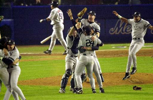 """<div class=""""meta image-caption""""><div class=""""origin-logo origin-image none""""><span>none</span></div><span class=""""caption-text"""">The New York Yankees celebrate after defeating the New York Mets in Game 5 of the World Series. (AP Photo/Bill Kostroun)</span></div>"""
