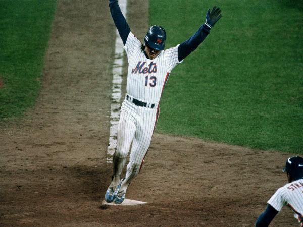 "<div class=""meta image-caption""><div class=""origin-logo origin-image none""><span>none</span></div><span class=""caption-text"">Mets Lee Mazzilli reacts as he crosses home plate to score the Mets third run in Game 6. (AP Photo/Susan Ragan) (AP Photo/ Susan Ragan)</span></div>"