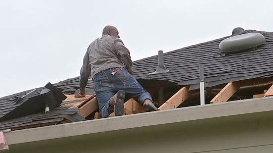 "<div class=""meta image-caption""><div class=""origin-logo origin-image none""><span>none</span></div><span class=""caption-text"">A man covers a hole in his roof following severe storms in the Houston area (KTRK Photo)</span></div>"