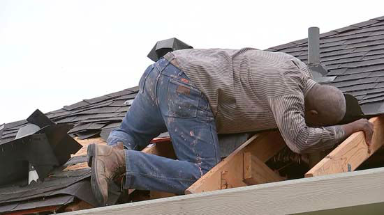 "<div class=""meta image-caption""><div class=""origin-logo origin-image none""><span>none</span></div><span class=""caption-text"">A man surveys damage to a roof following severe storms in the Houston area (KTRK Photo)</span></div>"