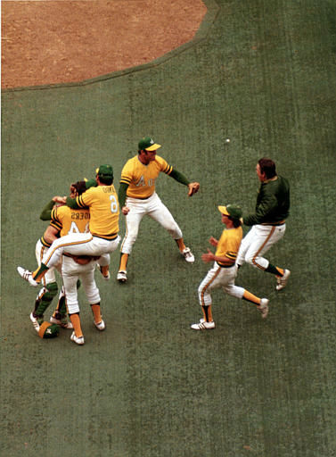 """<div class=""""meta image-caption""""><div class=""""origin-logo origin-image none""""><span>none</span></div><span class=""""caption-text"""">Oakland Athletics celebrate on the pitchers mound as they defeat the New York Mets 5:2 in Game 7, 1973. (AP Photo)</span></div>"""