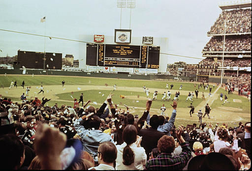 """<div class=""""meta image-caption""""><div class=""""origin-logo origin-image none""""><span>none</span></div><span class=""""caption-text"""">This is the scene at Shea Stadium as the Mets begin to celebrate their victory over the Baltimore Orioles at the World Series, Oct. 16, 1969. (AP Photo) (AP Photo/ XMB)</span></div>"""