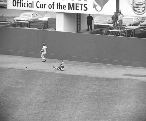 """<div class=""""meta image-caption""""><div class=""""origin-logo origin-image none""""><span>none</span></div><span class=""""caption-text"""">Mets center fielder Tommie Agee makes a sliding catch to rob Paul Blair with two outs and the bases loaded in the seventh inning of Game 3. (AP Photo)</span></div>"""