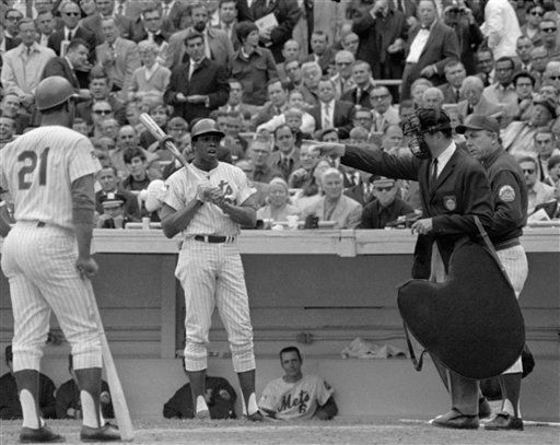 """<div class=""""meta image-caption""""><div class=""""origin-logo origin-image none""""><span>none</span></div><span class=""""caption-text"""">With Met manager Gil Hodges at his side, umpire Lou DiMuro awards Cleon Jones first base after a pitch hit him in Game 5. (AP Photo) (AP Photo/ XJM)</span></div>"""