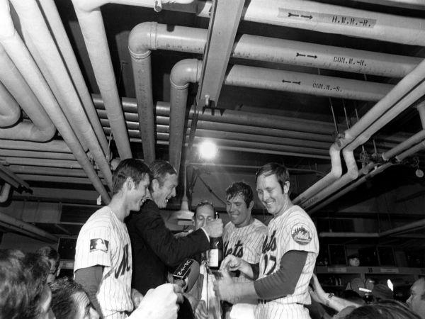"<div class=""meta image-caption""><div class=""origin-logo origin-image none""><span>none</span></div><span class=""caption-text"">New York City Mayor John Lindsay celebrates with the Mets in their Shea Stadium dressing room.  (AP Photo) (AP Photo/ XNBG)</span></div>"