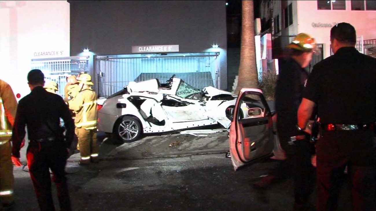 A car was crushed after a pursuit crash that left five injured, including a family of three, in Hollywood late Saturday, Oct. 24, 2015.
