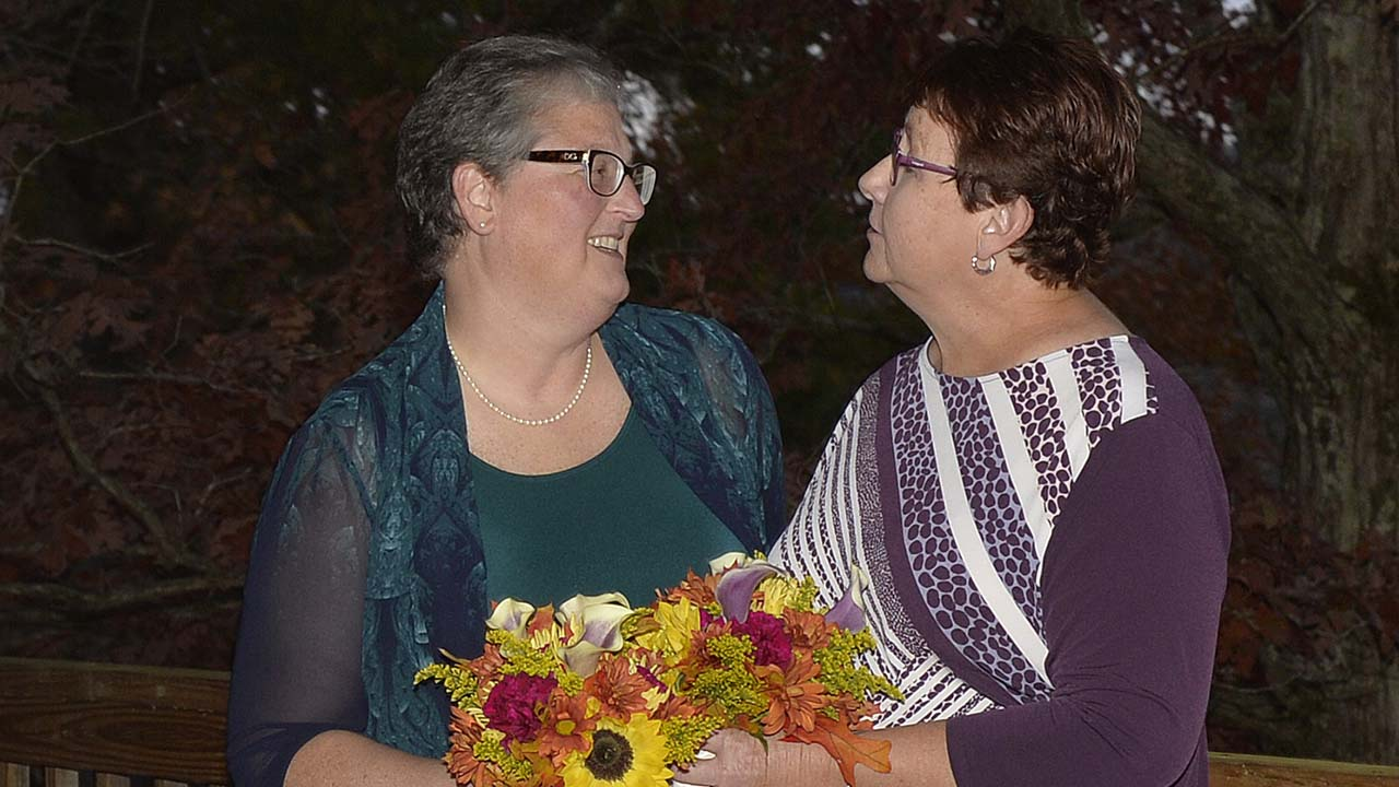 April Miller, left, and Karen Roberts before they renew their vows in a public ceremony, Saturday, Oct. 24, 2015, in Morehead, Kentucky.