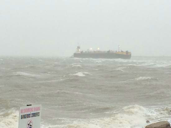 <div class='meta'><div class='origin-logo' data-origin='none'></div><span class='caption-text' data-credit='KTRK Photo/ KTRK'>The grounded tanker seen off the coast of Galveston near East Beach.</span></div>