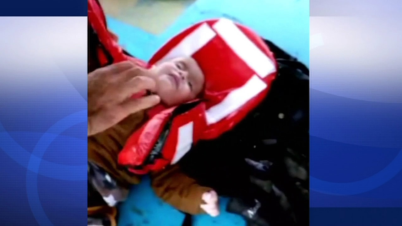 A fisherman helped save a little boy's life after a boat he was in sank on Aegean Sea on Wednesday, October 21, 2015.