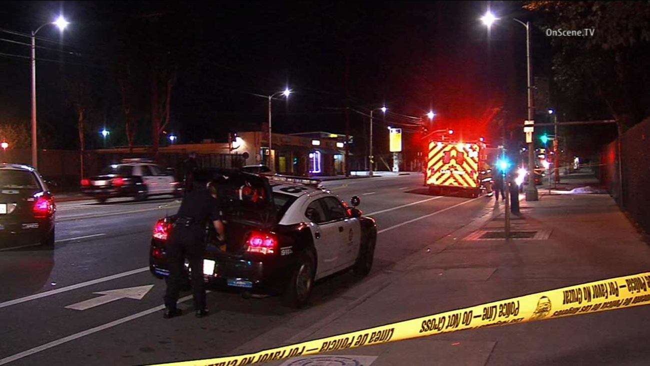 Los Angeles police investigate a fatal shooting near Van Nuys Boulevard and Norris Avenue in Pacoima on Monday, Oct. 26, 2015.
