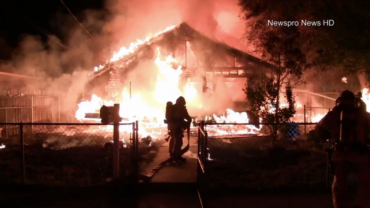 Firefighters work to stop a fire that engulfed a home in San Bernardino on Monday, Oct. 26, 2015.