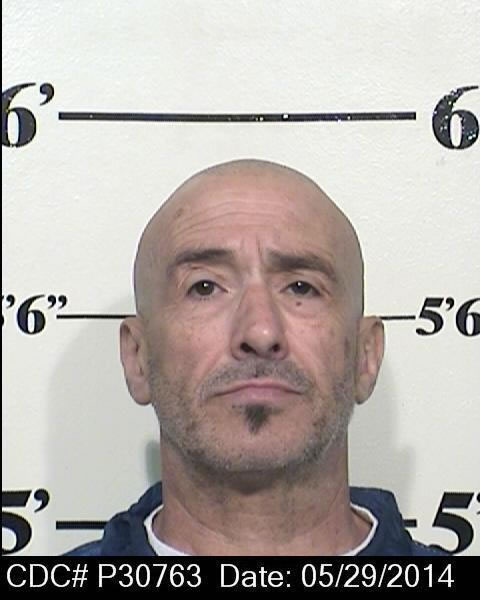 Michael Flores is pictured in a 2014 mug shot released by the California Department of Corrections and Rehabilitation.