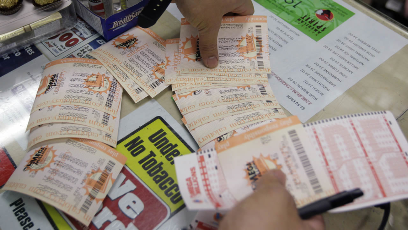 A customer collects lottery tickets that were purchased at a liquor store in Mountain View, Calif., Thursday, March 29, 2012, in hopes to win the Mega Millions lottery. (AP Photo/Paul Sakuma)