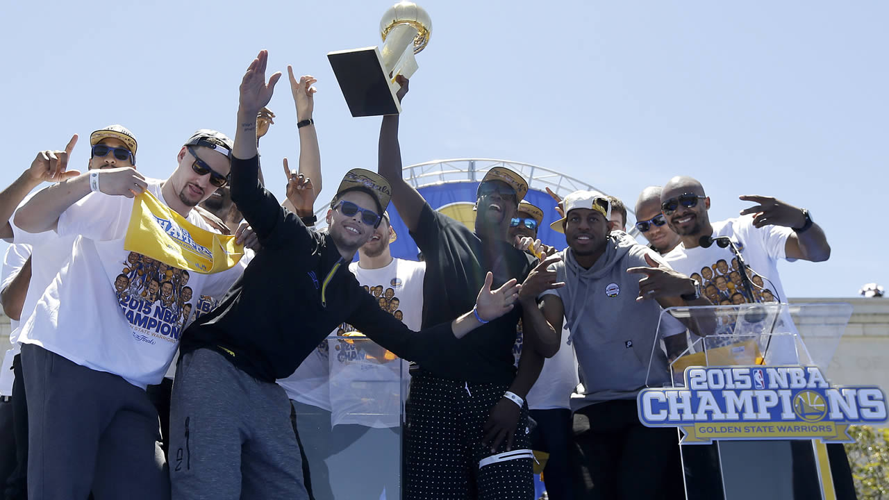 Golden State Warriors players celebrate after a parade and rally for winning the NBA championship in Oakland, Calif., Friday, June 19, 2015. (AP Photo/Jeff Chiu)