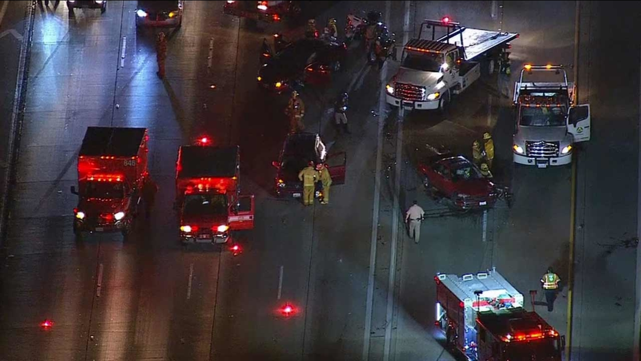 Emergency personnel respond to the scene of a multi-vehicle crash on the northbound 110 Freeway at Gage Avenue in South Los Angeles on Tuesday, Oct. 27, 2015.