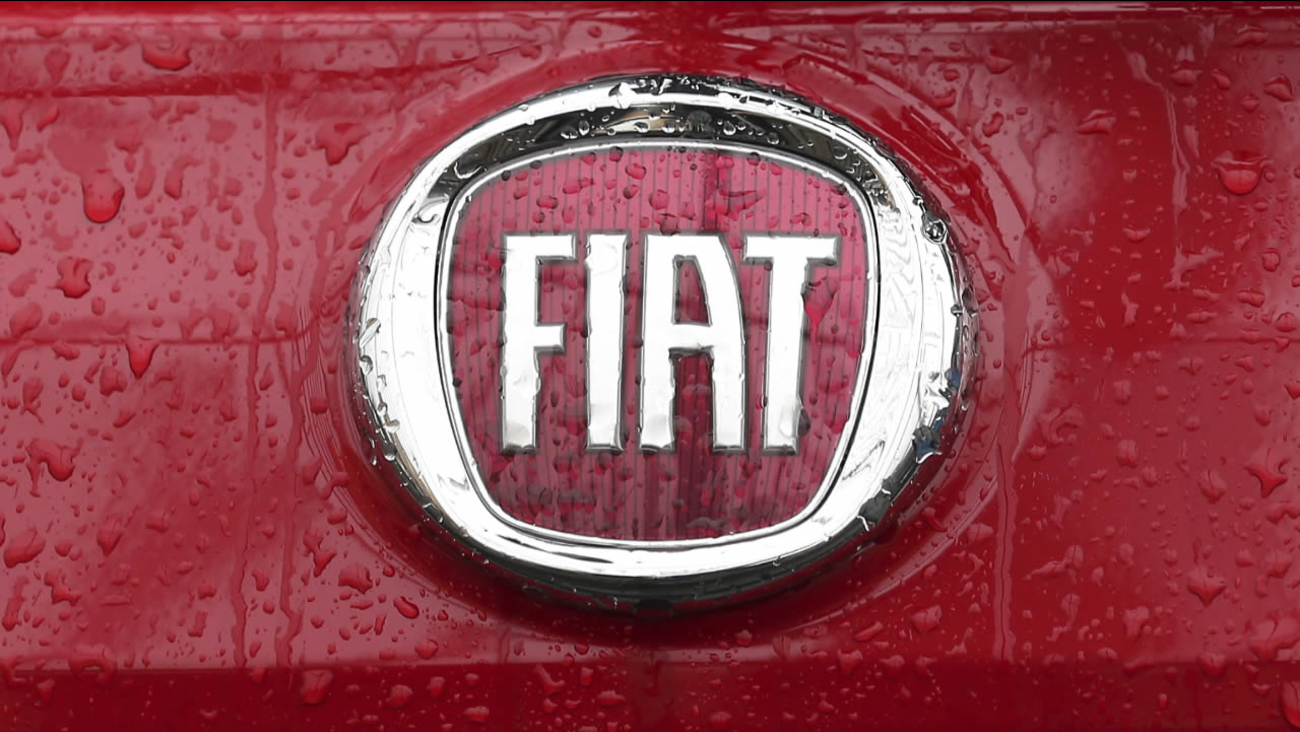 FILE - In this Thursday, Jan. 2, 2014 file photo, rain falls on a Fiat logo pictured on a car in Milan, Italy.