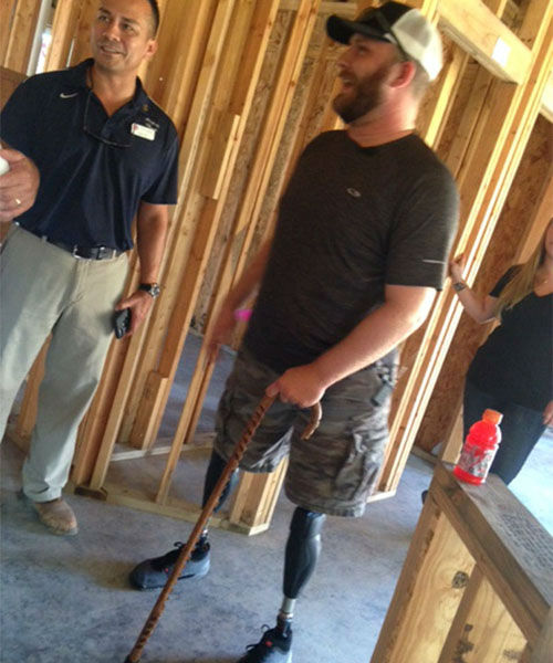 <div class='meta'><div class='origin-logo' data-origin='none'></div><span class='caption-text' data-credit='KTRK/Kevin Quinn'>A wounded Marine veteran and his family took a look at their new home being built and found many inspiring messages.</span></div>