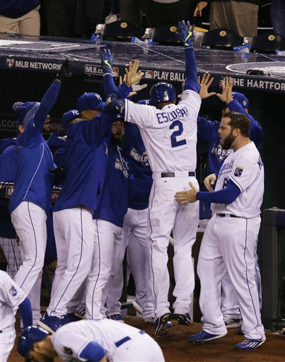 "<div class=""meta image-caption""><div class=""origin-logo origin-image none""><span>none</span></div><span class=""caption-text"">Royals Alcides Escobar (2) celebrates with his teammates after scoring on an in-the-park home run. (AP Photo/Orlin Wagner) (AP Photo/ Orlin Wagner)</span></div>"