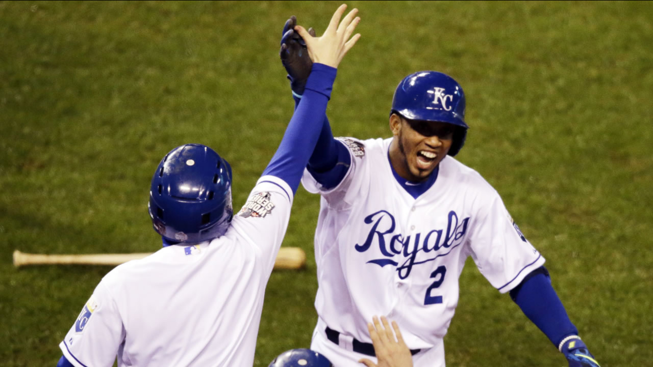 Kansas City Royals' Alcides Escobar celebrates after hitting an inside-the-park home run during the first inning of Game 1 of the Major League Baseball World Series.