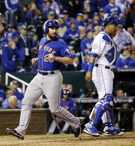 "<div class=""meta image-caption""><div class=""origin-logo origin-image none""><span>none</span></div><span class=""caption-text"">Mets' Daniel Murphy (28) scores past Kansas City Royals catcher Salvador Perez during the fourth inning of Game 1. (AP Photo/David J. Phillip) (AP Photo/ David J. Phillip)</span></div>"