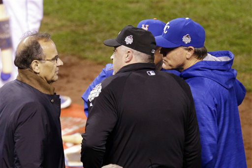"<div class=""meta image-caption""><div class=""origin-logo origin-image none""><span>none</span></div><span class=""caption-text"">MLB Executive Joe Torre talks to Mets manager Terry Collins and Royals manager Ned Yost during a television technical interruption. (AP Photo/David Goldman) (AP Photo/ David Goldman)</span></div>"