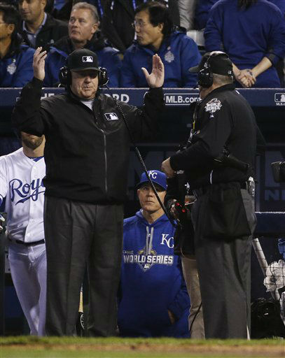 "<div class=""meta image-caption""><div class=""origin-logo origin-image none""><span>none</span></div><span class=""caption-text"">Umpires speak to their headquarters television technical delay during the fourth inning of Game 1. (AP Photo/Matt Slocum) (AP Photo/ Matt Slocum)</span></div>"