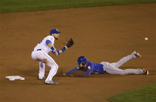 "<div class=""meta image-caption""><div class=""origin-logo origin-image none""><span>none</span></div><span class=""caption-text"">Mets' Juan Lagares (12) steals second base on a late throw to Royals second baseman Ben Zobrist during the eighth inning. (AP Photo/Orlin Wagner) (AP Photo/ Orlin Wagner)</span></div>"