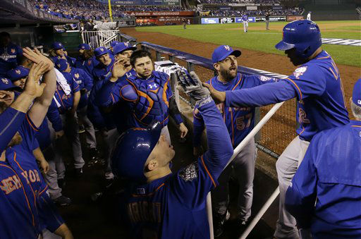 "<div class=""meta image-caption""><div class=""origin-logo origin-image none""><span>none</span></div><span class=""caption-text"">Mets' Juan Lagares is congratulated after scoring on a hit by Mets' Wilmer Flores during the eighth inning of Game 1. (AP Photo/Matt Slocum) (AP Photo/ Matt Slocum)</span></div>"