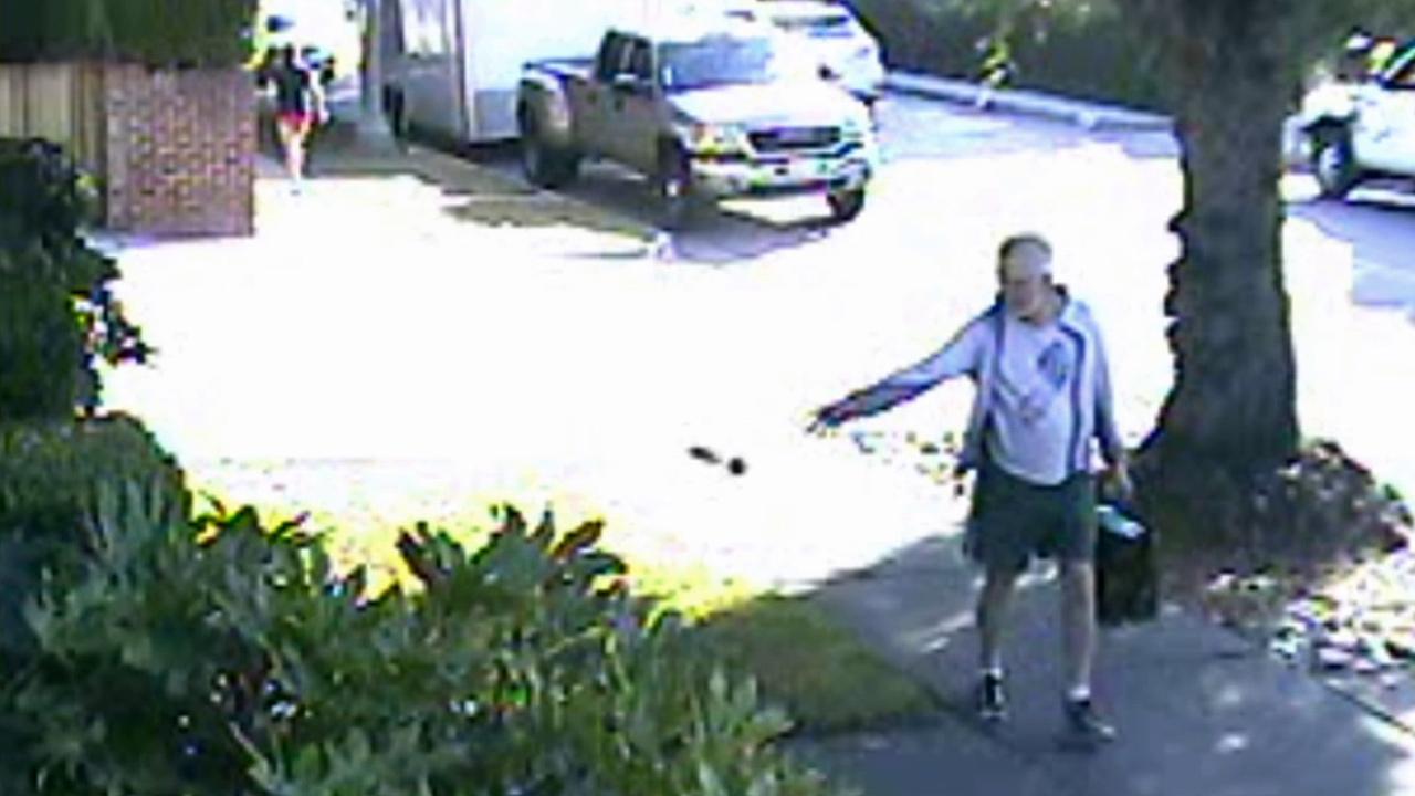 San Marino Mayor Dennis Kneier tosses a bag of poop on a neighbor's property on Saturday, June 7, 2014.