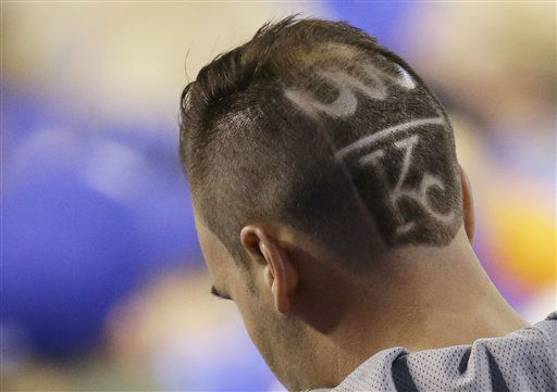 "<div class=""meta image-caption""><div class=""origin-logo origin-image none""><span>none</span></div><span class=""caption-text"">A Kansas City Royals fan makes his way to his seat during the third inning of Game 2 of the Major League Baseball World Series. (AP Photo/ David Goldman)</span></div>"