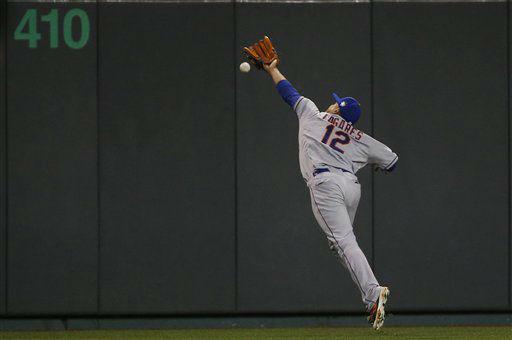 "<div class=""meta image-caption""><div class=""origin-logo origin-image none""><span>none</span></div><span class=""caption-text"">Mets center fielder Juan Lagares can't catch an RBI double by Kansas City Royals' Alex Gordon during the eighth inning. (AP Photo/Matt Slocum) (AP Photo/ Matt Slocum)</span></div>"