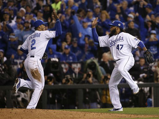 "<div class=""meta image-caption""><div class=""origin-logo origin-image none""><span>none</span></div><span class=""caption-text"">Royals pitcher Johnny Cueto (47) celebrates with Alcides Escobar after a ground ended the seventh inning of Game 2. (AP Photo/Matt Slocum) (AP Photo/ Matt Slocum)</span></div>"