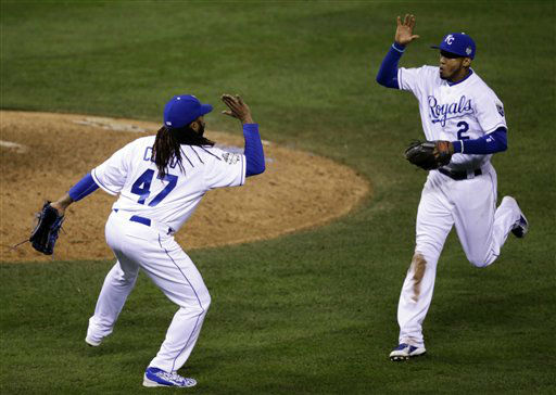 "<div class=""meta image-caption""><div class=""origin-logo origin-image none""><span>none</span></div><span class=""caption-text"">Royals pitcher Johnny Cueto (47) and Alcides Escobar (2) celebrate the end of the top of the eighth inning, Mo. (AP Photo/David Goldman) (AP Photo/ David Goldman)</span></div>"