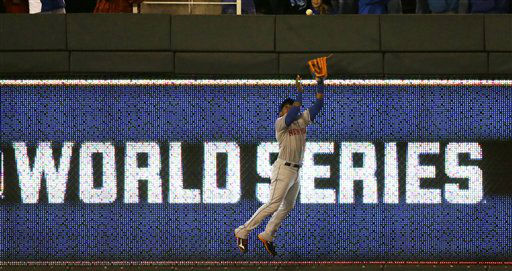 "<div class=""meta image-caption""><div class=""origin-logo origin-image none""><span>none</span></div><span class=""caption-text"">Mets' Yoenis Cespedes catches a ball at the wall hit by Kansas City Royals' Alex Rios during the fifth inning of Game 2. (AP Photo/David Goldman) (AP Photo/ David Goldman)</span></div>"