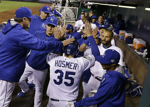 "<div class=""meta image-caption""><div class=""origin-logo origin-image none""><span>none</span></div><span class=""caption-text"">Royals' Eric Hosmer is congratulated after scoring during the fifth inning of Game 2. (AP Photo/David J. Phillip) (AP Photo/ David J. Phillip)</span></div>"