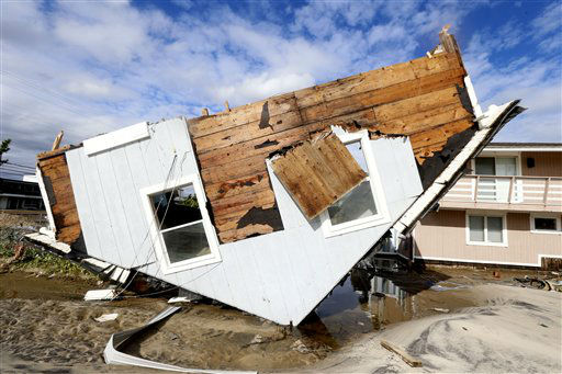 "<div class=""meta image-caption""><div class=""origin-logo origin-image none""><span>none</span></div><span class=""caption-text"">Part of a home rests upside-down in Seaside Heights, N.J. on Wednesday, Oct. 31, 2012 after superstorm Sandy made landfall in New Jersey on Monday evening. (AP Photo/ Julio Cortez)</span></div>"