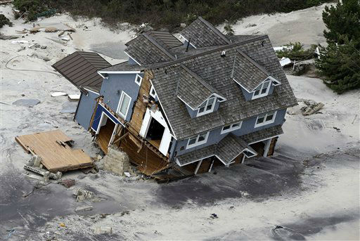 "<div class=""meta image-caption""><div class=""origin-logo origin-image none""><span>none</span></div><span class=""caption-text"">This aerial photo shows a collapsed house along the central Jersey Shore coast on Wednesday, Oct. 31, 2012. (AP Photo/ Mike Groll)</span></div>"