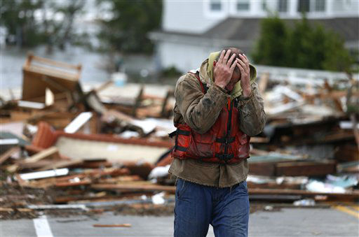 "<div class=""meta image-caption""><div class=""origin-logo origin-image none""><span>none</span></div><span class=""caption-text"">Brian Hajeski, 41, of Brick, N.J., reacts after looking at debris of a home that washed up on to the Mantoloking Bridge the morning after superstorm Sandy. (AP Photo/ Julio Cortez)</span></div>"