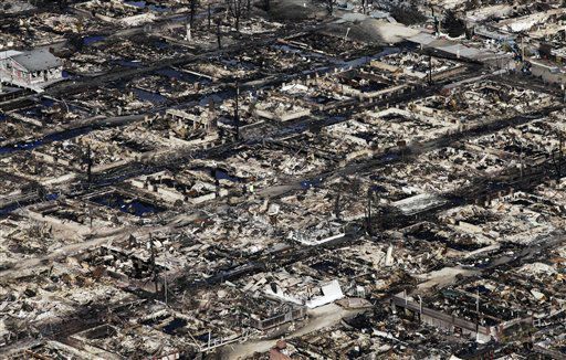 "<div class=""meta image-caption""><div class=""origin-logo origin-image none""><span>none</span></div><span class=""caption-text"">This Wednesday, Oct. 31, 2012 aerial file photo shows the Breezy Point neighborhood where more than 50 homes burned to the ground as a result of Superstorm Sandy. (AP Photo/ Mark Lennihan)</span></div>"