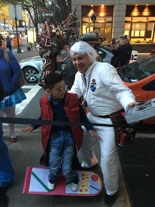 "<div class=""meta image-caption""><div class=""origin-logo origin-image none""><span>none</span></div><span class=""caption-text"">Sean Gonzalez, 9, and his dad Luis dress as Marty McFly and Doc Brown from ''Back to the Future'' for the ''LIVE with Kelly and Michael'' costume contest. (Bob Monek. Eyewitness News)</span></div>"