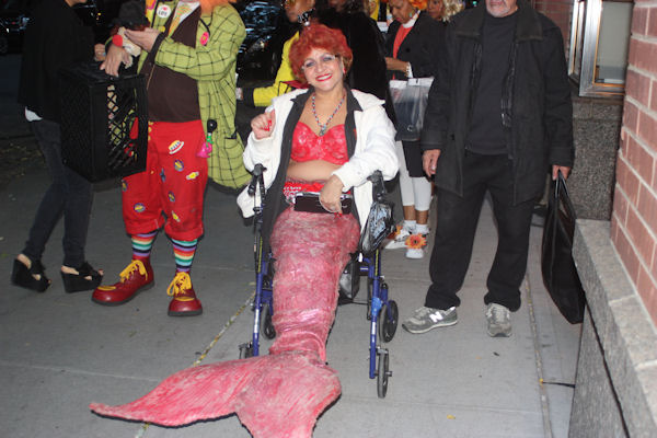 "<div class=""meta image-caption""><div class=""origin-logo origin-image none""><span>none</span></div><span class=""caption-text"">An audience member dresses as a mermaid for the ''LIVE with Kelly and Michael'' costume contest. (Bob Monek. Eyewitness News)</span></div>"