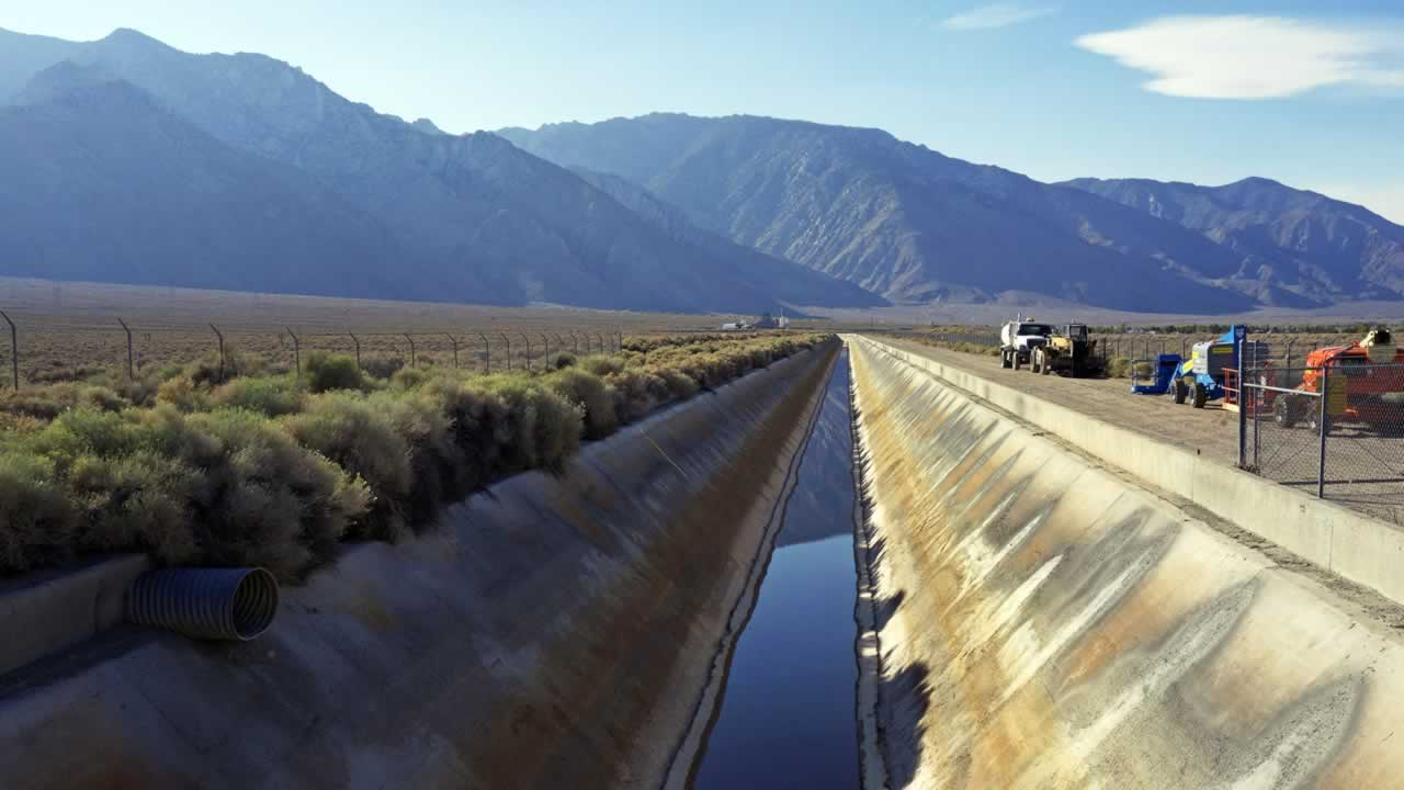 In this Aug. 23, 2015, photo, the Los Angeles Aqueduct has reduced water flow near the eastern Sierra town of Olancha, Calif.