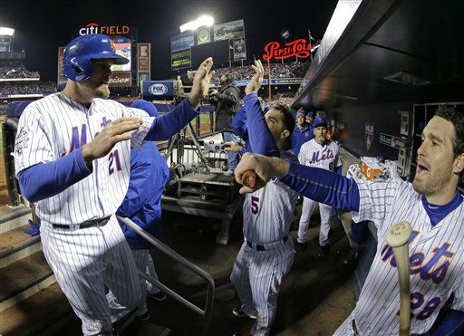 "<div class=""meta image-caption""><div class=""origin-logo origin-image none""><span>none</span></div><span class=""caption-text"">New York Mets' Lucas Duda (21) is congratulated in the dugout. (AP Photo/ David J. Phillip)</span></div>"