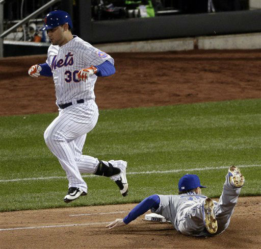 "<div class=""meta image-caption""><div class=""origin-logo origin-image none""><span>none</span></div><span class=""caption-text"">Kansas City Royals first baseman Eric Hosmer fails to make the out as New York Mets' Michael Conforto reaches first. (AP Photo/ Charlie Riedel)</span></div>"