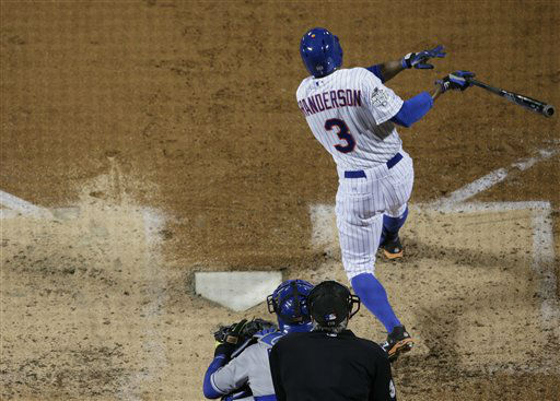 "<div class=""meta image-caption""><div class=""origin-logo origin-image none""><span>none</span></div><span class=""caption-text"">New York Mets' Curtis Granderson hits a two-run home run during the third inning of Game 3. (AP Photo/ Peter Morgan)</span></div>"
