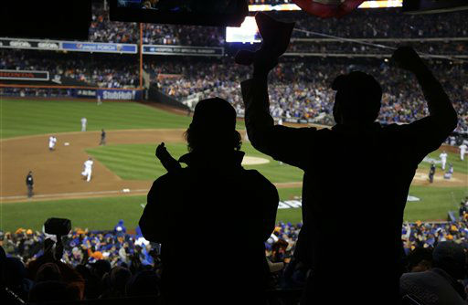 "<div class=""meta image-caption""><div class=""origin-logo origin-image none""><span>none</span></div><span class=""caption-text"">Fans cheer after New York Mets' Curtis Granderson hit a two run home run during the third inning of Game 3. (AP Photo/ Julie Jacobson)</span></div>"