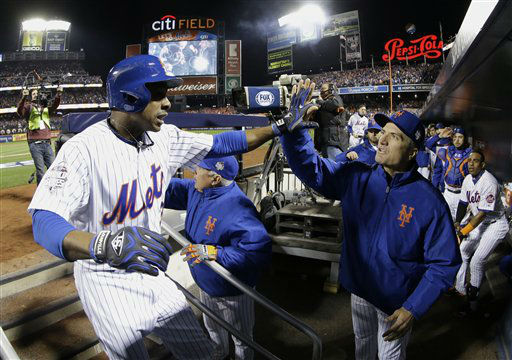 "<div class=""meta image-caption""><div class=""origin-logo origin-image none""><span>none</span></div><span class=""caption-text"">New York Mets' Curtis Granderson celebrates after hitting a two-run home run. (AP Photo/ David J. Phillip)</span></div>"