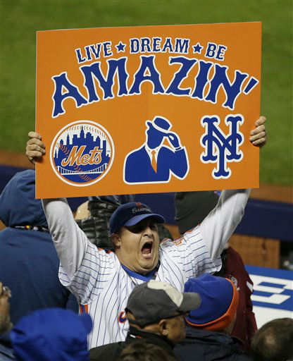 "<div class=""meta image-caption""><div class=""origin-logo origin-image none""><span>none</span></div><span class=""caption-text"">New York Mets fans cheer during the sixth inning. (AP Photo/ Frank Franklin II)</span></div>"