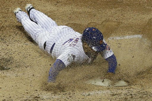 "<div class=""meta image-caption""><div class=""origin-logo origin-image none""><span>none</span></div><span class=""caption-text"">New York Mets' Juan Lagares scores on a hit by Juan Uribe. (AP Photo/ David J. Phillip)</span></div>"